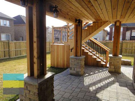 level cedar deck  wrought iron railings pergola