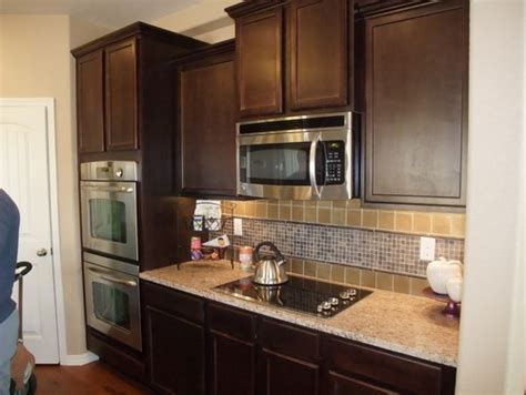 what color should i paint my kitchen cabinets should i paint my dark kitchen cabinets
