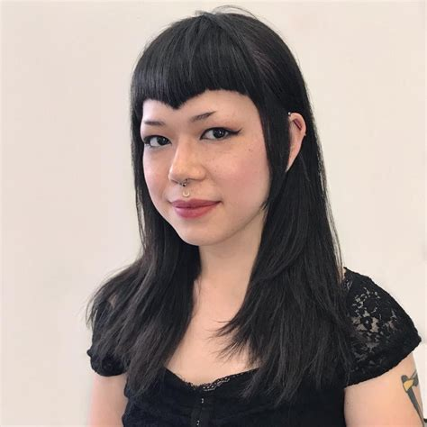 s edgy framing layered cut with curved v shaped bangs and black hair color medium