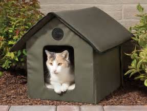 baby bottle candles heated outdoor cat house the green