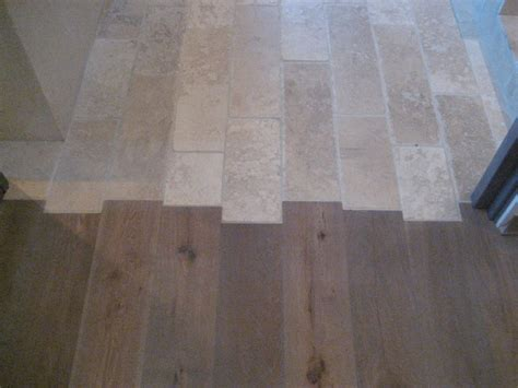 tile flooring next to hardwood flooring traditional hardwood flooring chicago by mark hickman homes