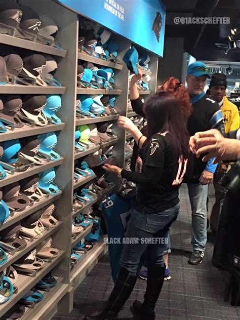 carolina panthers fan shop female falcons fan switching her loyalty to the panthers