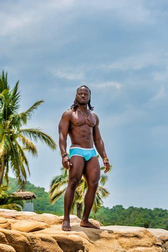 muscular african american man standing   rock stock photo  image  istock