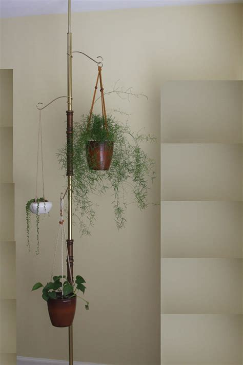 vintage tension pole hanging plant stand by