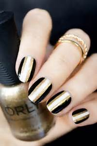 Black and gold new years nails version