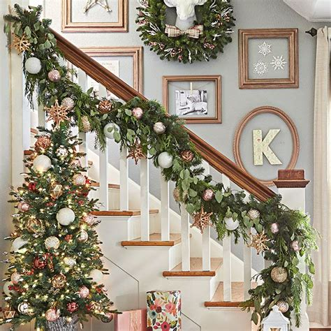 christmas decorations banister nothing says christmas like a green garland shimmering with ornaments and draping a banister