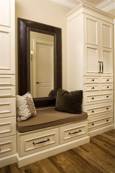 walk in closet with a cushioned bench home design