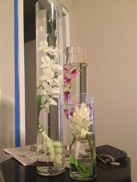 trial run with real and fake submerged orchid centerpieces