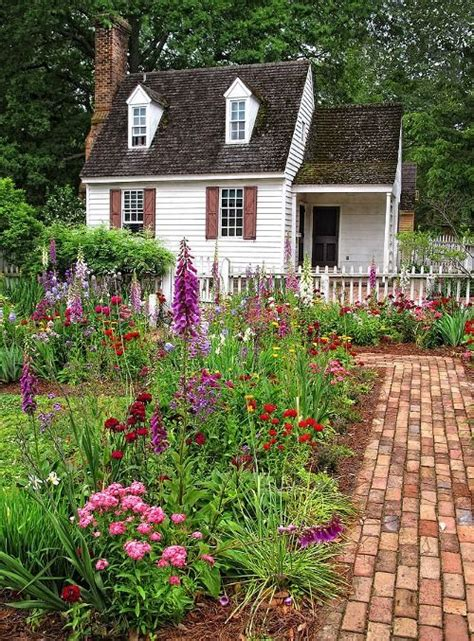 Pretty English Garden Leading To An Adorable Cottage