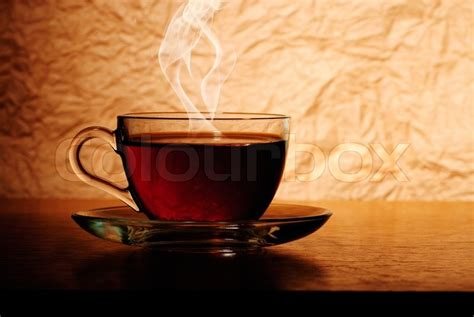 glass cup  black tea  wooden table  smoke stock