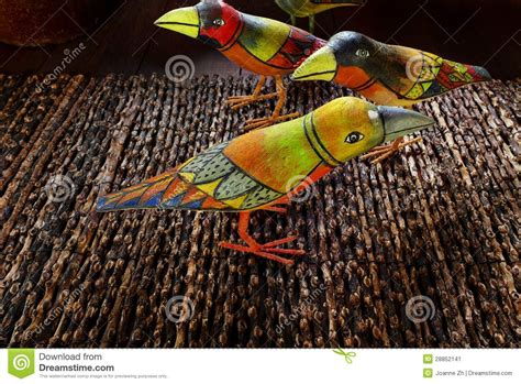 indonesian ethnic art painted wooden birds stock image