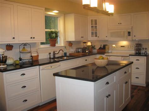white kitchen cabinets with brown countertops my kitchen shiloh cabinets with inset doors in soft white 2067