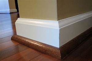 This is important molding1 4 round stained the same for White baseboards with wood floors