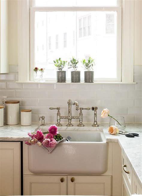 Bridge Sink Faucet by Ivory Kitchen Cabinets With Beveled Subway Tile Backsplash