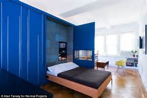 hiding bed in studio folding manhattan studio apartment that turns into a four bedroom unit daily mail online