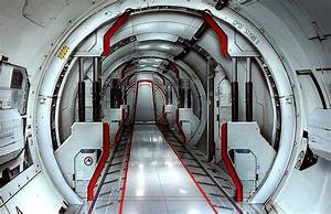 Corridor inside a toroidal space station by Sam Brown. # ...