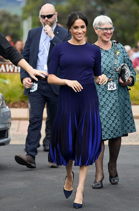queen letizia channels meghan markle  chic blue pleated