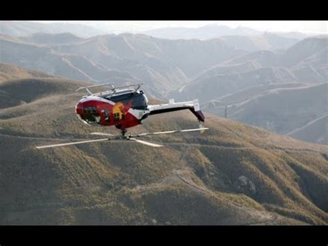 Bull Helicopter Pilot by Helicopter Pilot Chuck Aaron Performs A Series Of