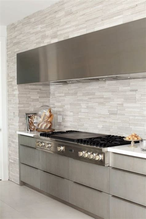 gray kitchen with frameless gray cabinets paired with