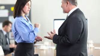 Two Business People Talking