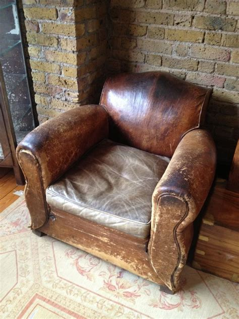 rejuvenation salvage sighting  worn leather arm chair