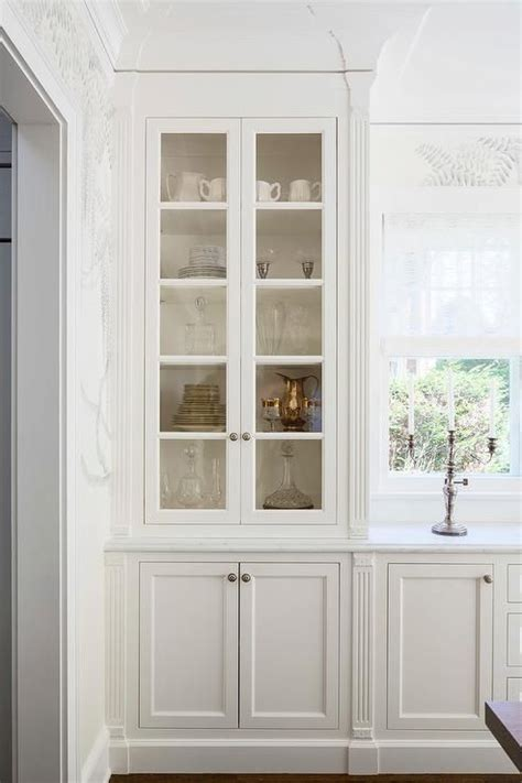 dining room hutch with glass doors chic dining room features a built in sideboard topped with