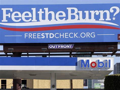gas station billboard slogan stds california highs third row burn raging feel reads above sexually diseases transmitted candidate bernie sanders
