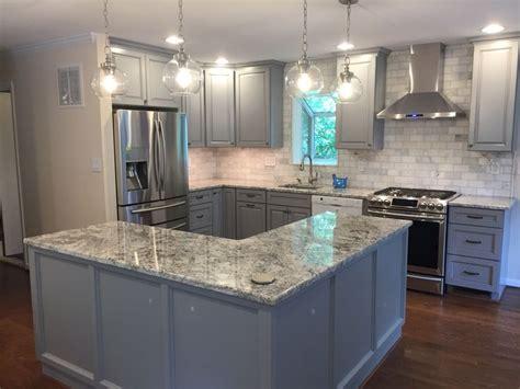 bright blue grey kitchen created  baltic bay