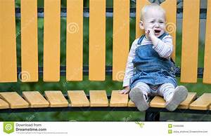 Sad Little Girl Sitting Alone On A Bench. Royalty Free ...