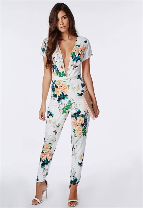 plunge jumpsuit missguided floral plunge jumpsuit white lyst