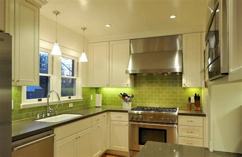 do you tile kitchen cabinets def wanna do green glass tiles like this with lighting 9606