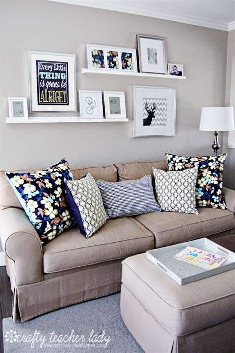 Many rustic wall arrangements are cluttered, but this one features only eight matted prints. 33 Beige Living Room Ideas - Decoholic