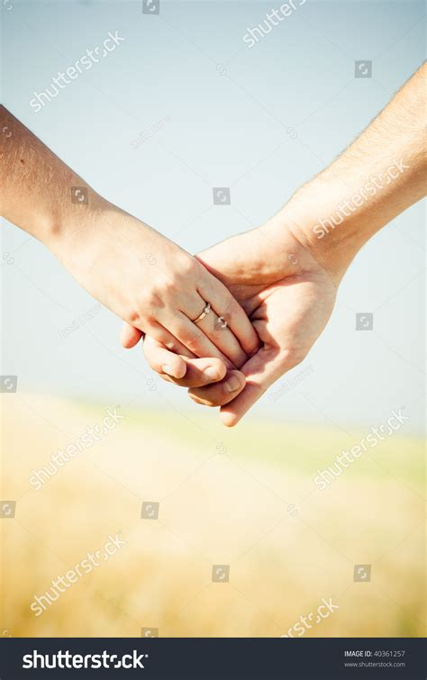 close  holding hands  wedding ring stock photo  shutterstock