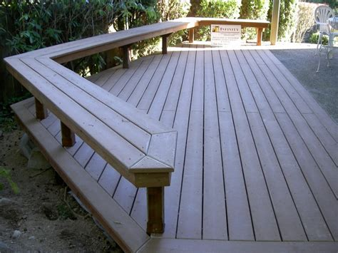 trex deck benches up to concrete patio decks by infinity construction deck