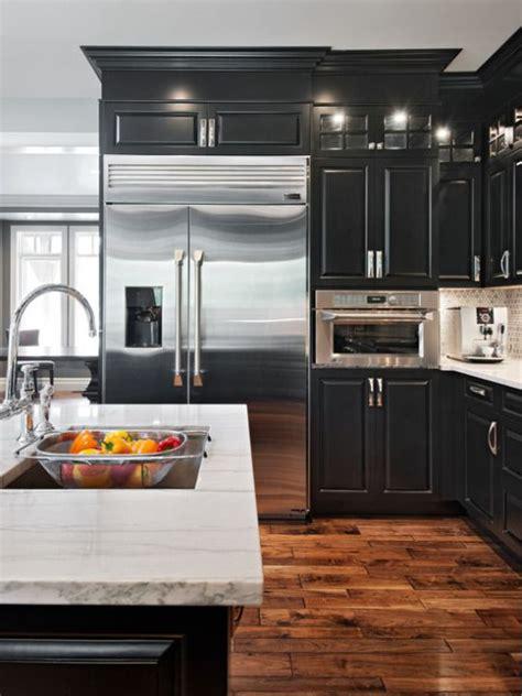 black cabinets  white granite counters  distressed