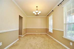 view of formal dining room from the doorway nice chair With two tone dining room color ideas