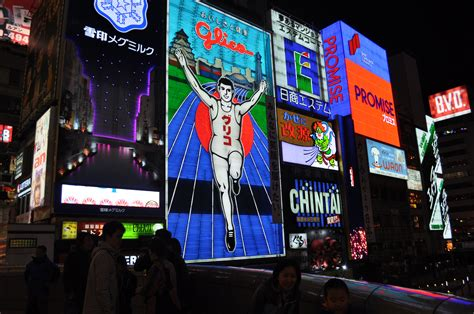 fileglico man sign dotonborijpg wikimedia commons