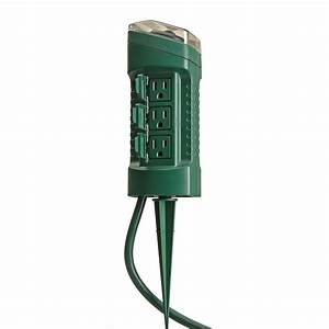 Woods outdoor outlet yard stake with photocell light