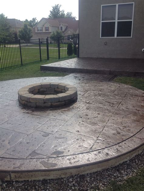 a beautifully designed colored sted concrete patio