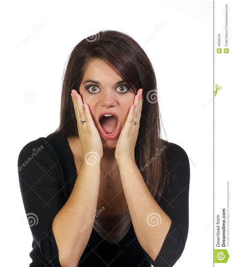 Young Woman With Hands Holding Her Face Surprised Stock
