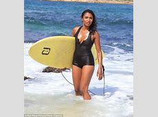 Sara Martins shows off her slim figure in plunging one