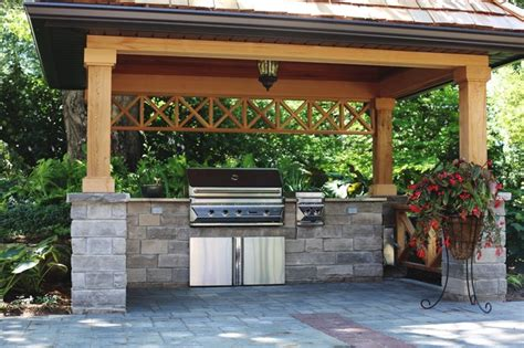 Remodeling Ideas For Small Kitchens - covered bbq area with natural stone counters traditional patio toronto by heritage