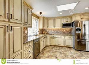 luxury kitchen interior with back splash trim and tile With kitchen colors with white cabinets with stock market wall art