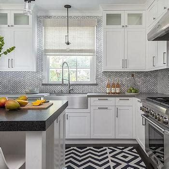 White and Gray Kitchen with Gray Marble Herringbone Tile