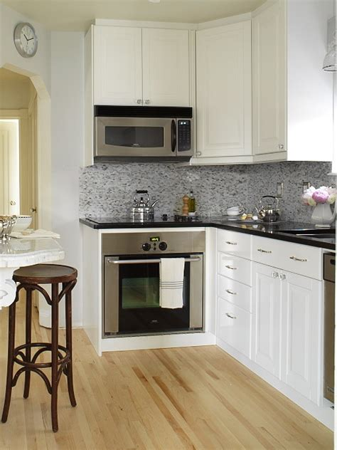 white cabinets with black granite countertops design