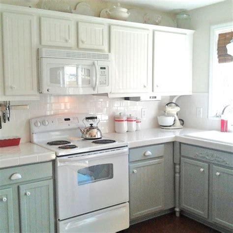 sage green kitchen cabinets  white appliances
