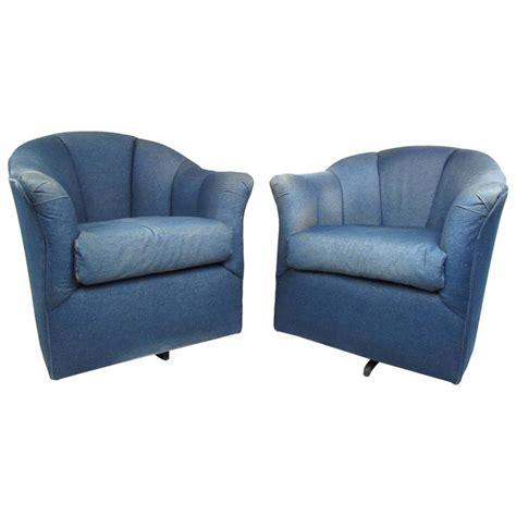 pair of mid century style swivel denim lounge chairs for