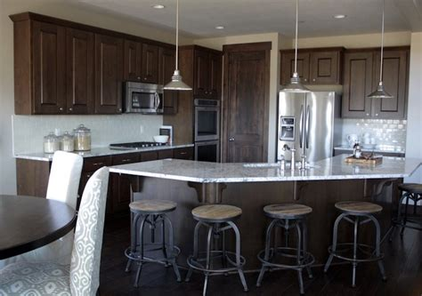 moon white granite with dark cabinets transitional kitchen
