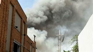 smoke coming from the side of a building stock