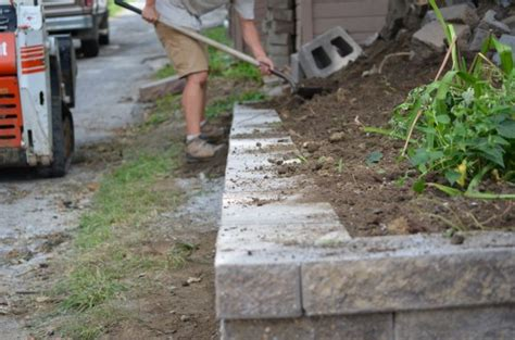 backfilling a retaining wall how to build a retaining wall omaha landscape design